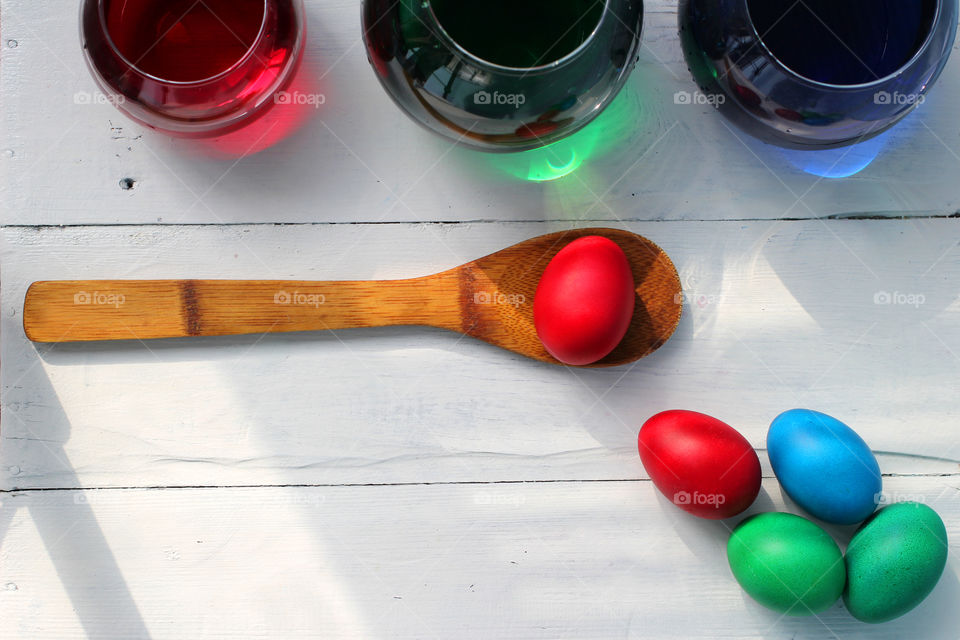 High angle view of easter eggs and colored bottles