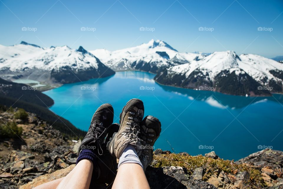 Two people's legs and view of landscape