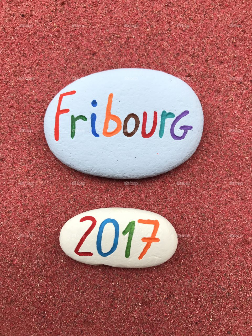 Fribourg 2017, souvenir on painted stones over red sand