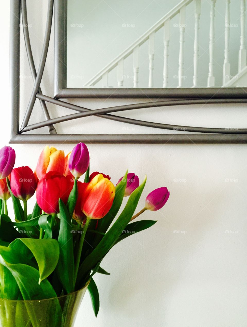 Fresh tulips mirror and staircase