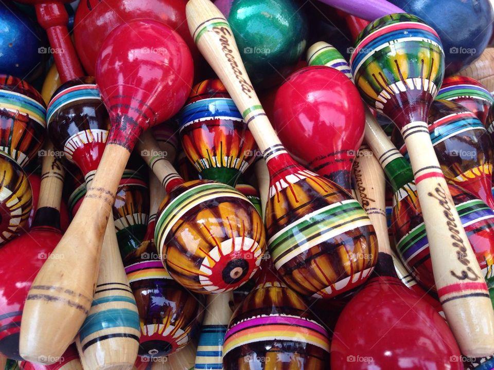 Full frame of multicolor maracas
