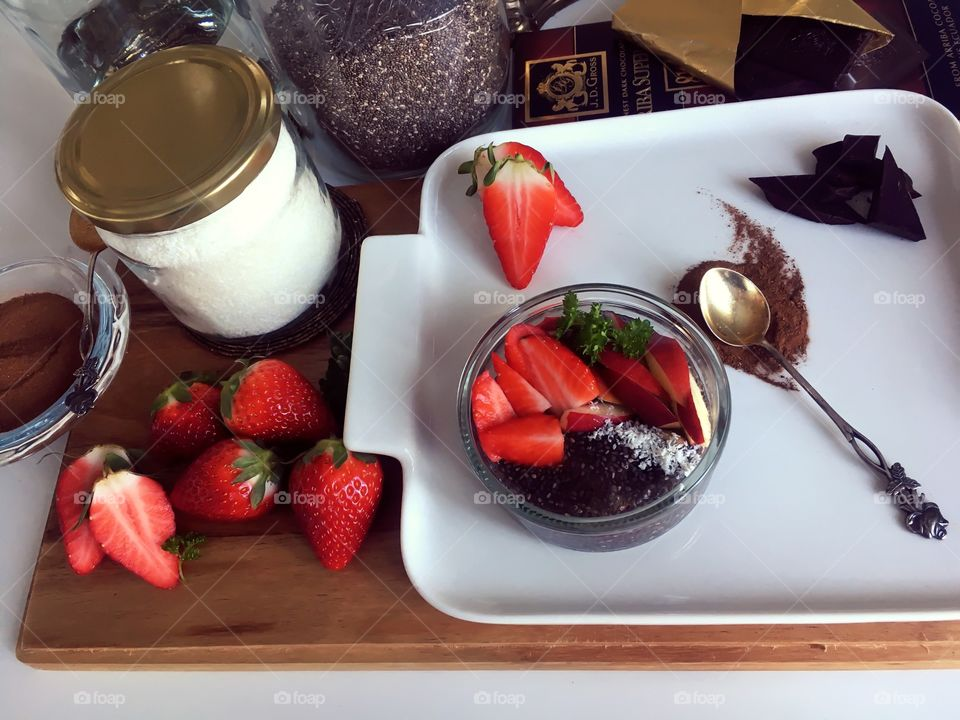 Cooking at home! Luxurious homemade healthy dessert. Ingredients around the dessert plate. Warm and bright colors make food plate look delicious.