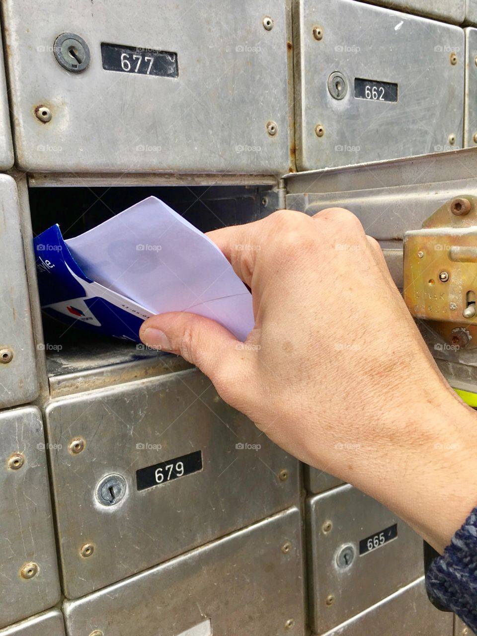 Taking out letters from the mailbox