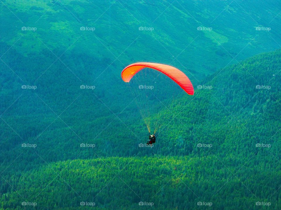 View of a person paragliding