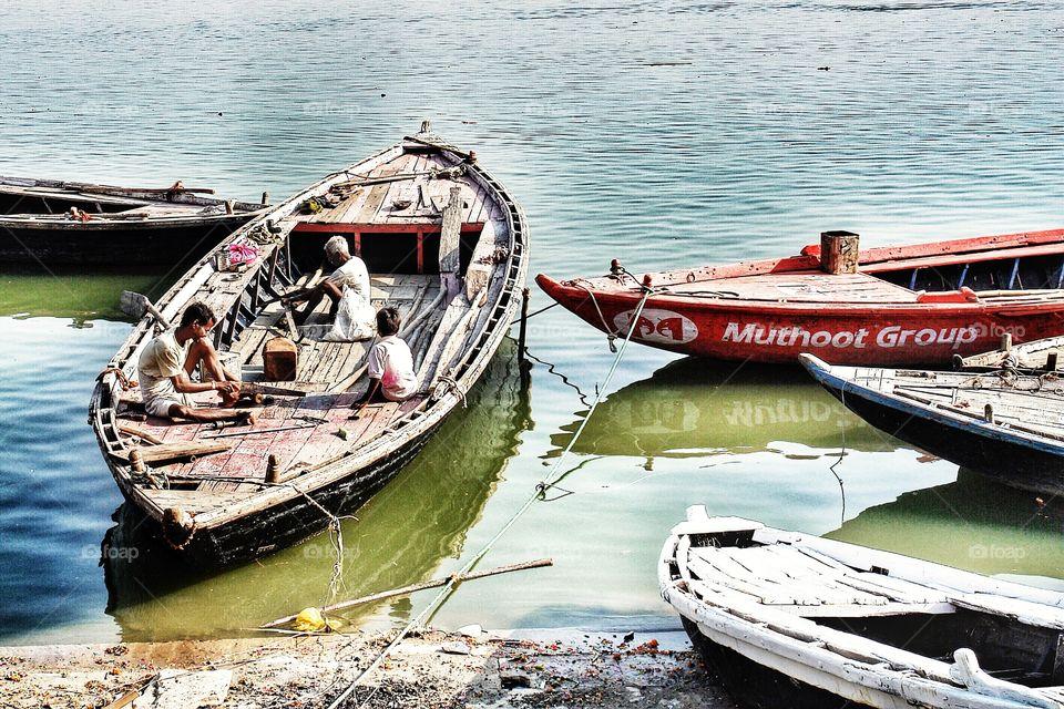 Men working on Boat, River Ganges, Varanasi, India   . Men working on Boat, River Ganges, Varanasi, India