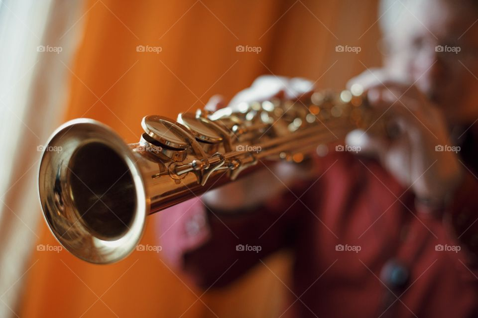 Closeup of man playing trumpet