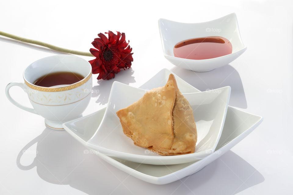 Indian dish samosa in white cutlery
