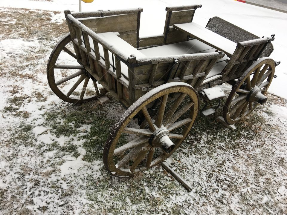 Old horse carriage in snow