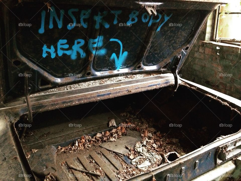 Graffiti on a car we found in an abandoned blimp factory.
