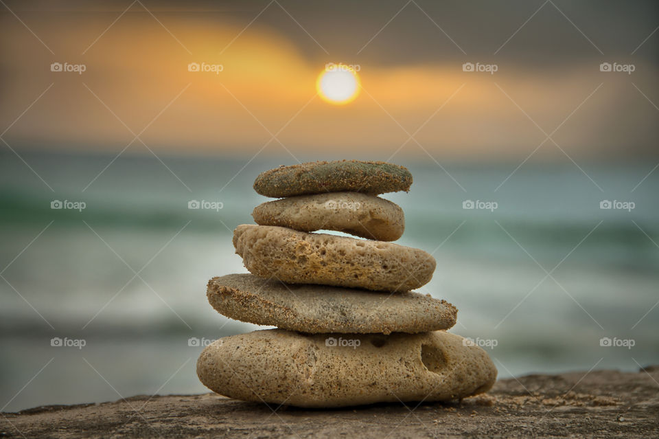 Closeup of a stack of stones on rock