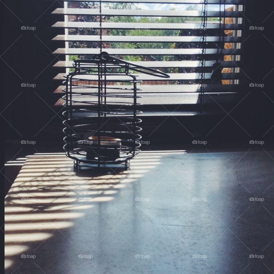 Horizontal bands. Horizontal bands on the window, on candlestick form a striped shadow