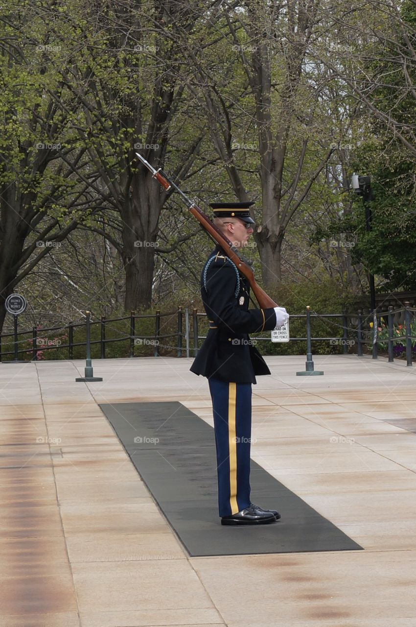 Marching at tomb of the unknown soldier at Arlington Cemetery in Arlington VA, USA.