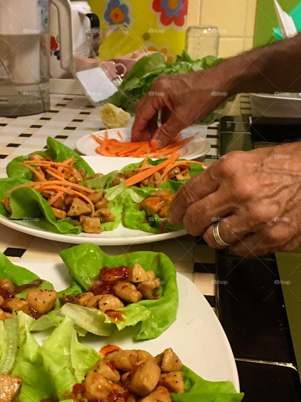 Working hands preparing Asian lettuce wraps.