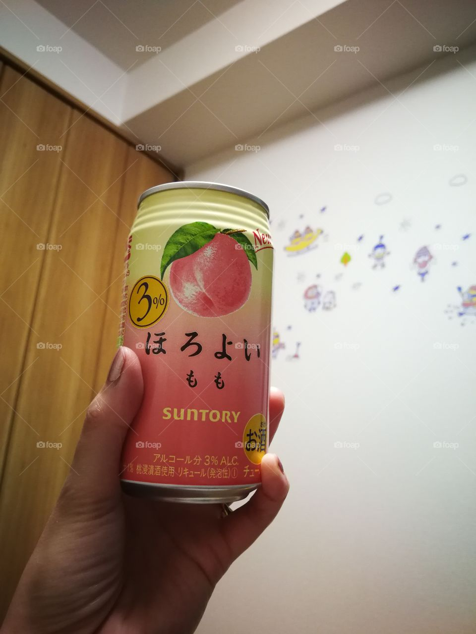 Taking a sip of a peach alcoholic drink