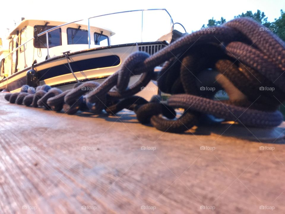 Chained.  Boat anchored  at Erie Canal  @ Brockport NY.