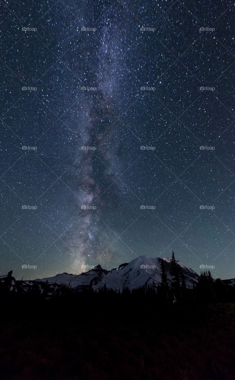 Majestic Milky Way shines over Mount Rainier as mountaineers start their summit push