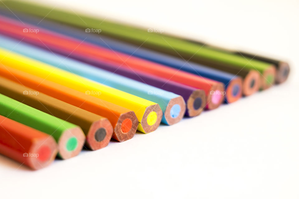 Close-up of colour pencils against white background