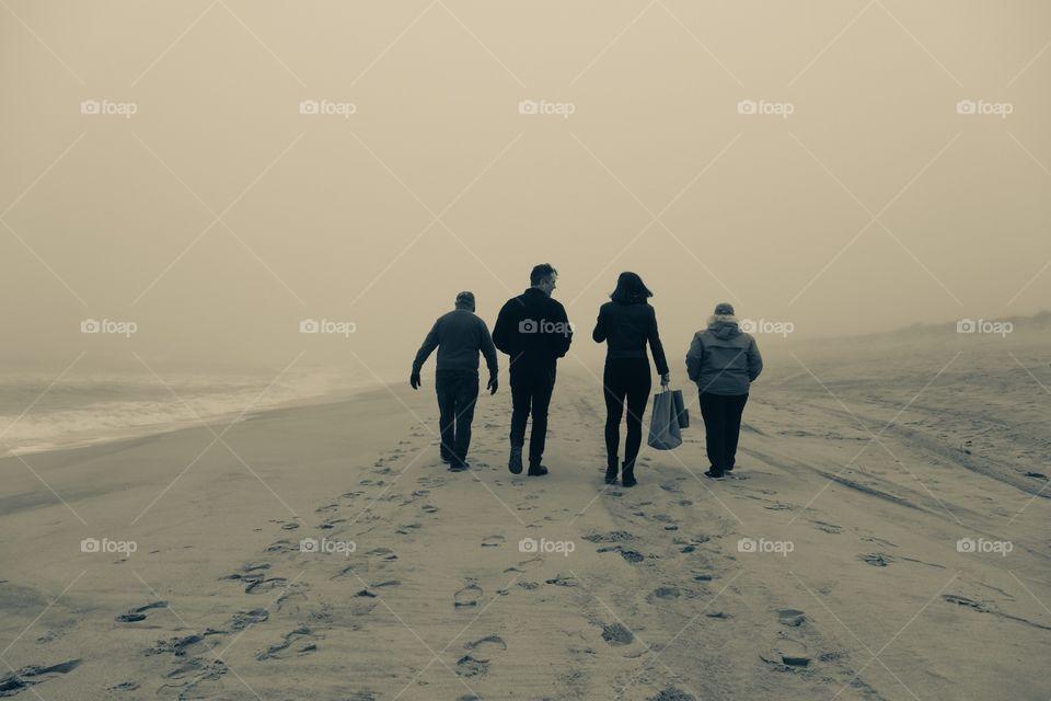 Monochromatic Family Walking On The Beach, Beach Walk In The Fog, Moving Forward, Walking On A Beach In New York, Monochrome Beach Scene