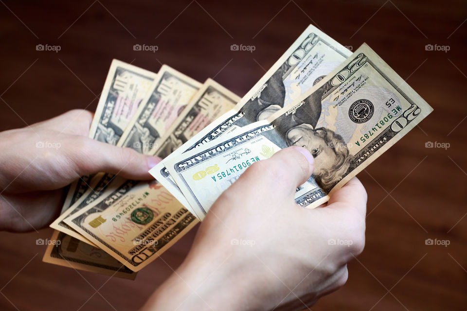 Close-up of person's holding banknote