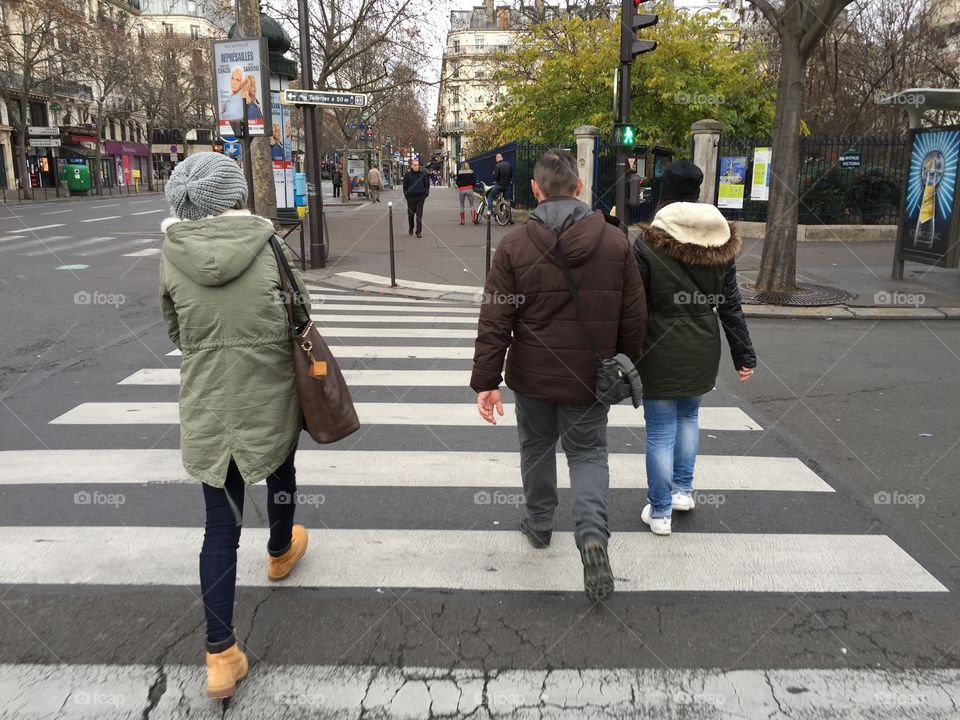 Pedestrians crossing the road on the pedestrian crossing