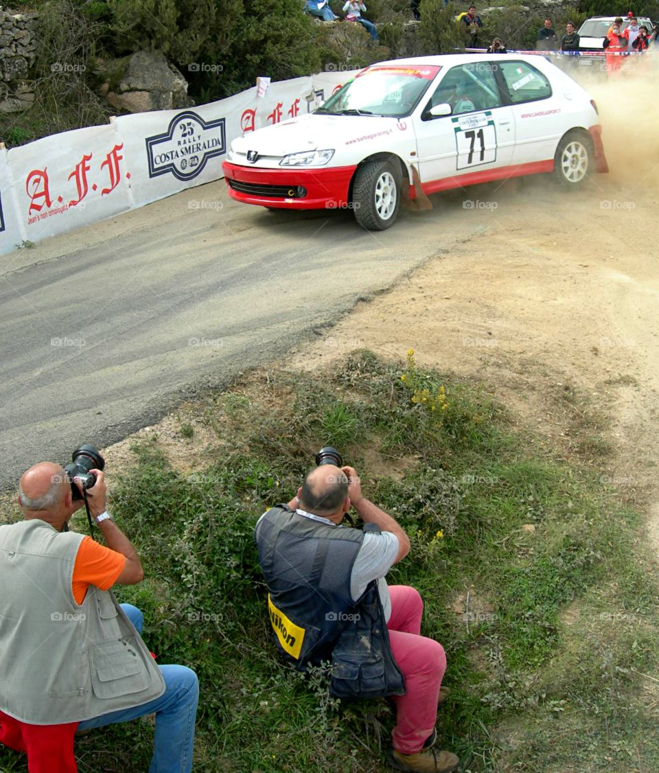 photographeurs in action in a rally competition