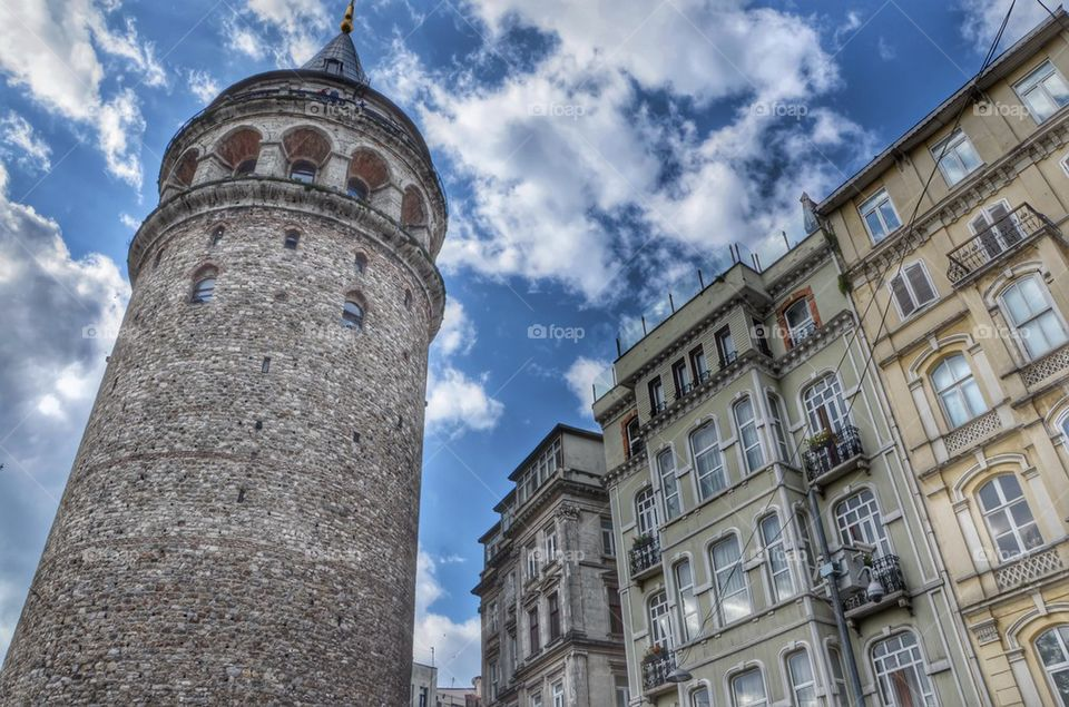 Galata tower between houses, Istanbul, Turkey