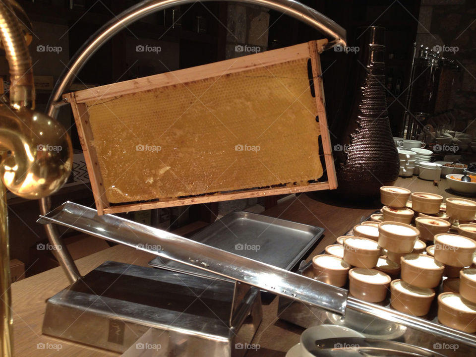 Honey dispensed directly from the honeycomb at breakfast