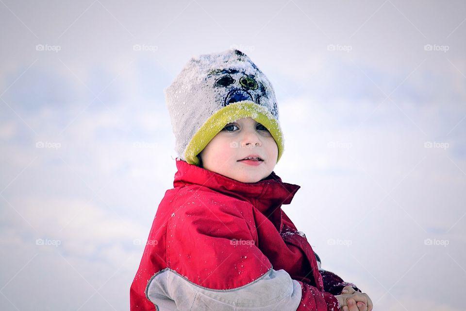 Cute boy wearing knit hat