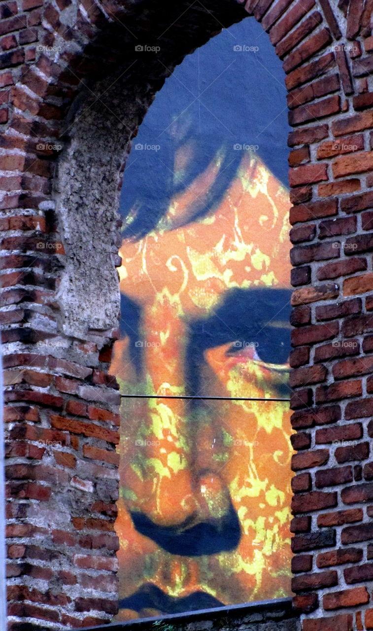 face into the window brick