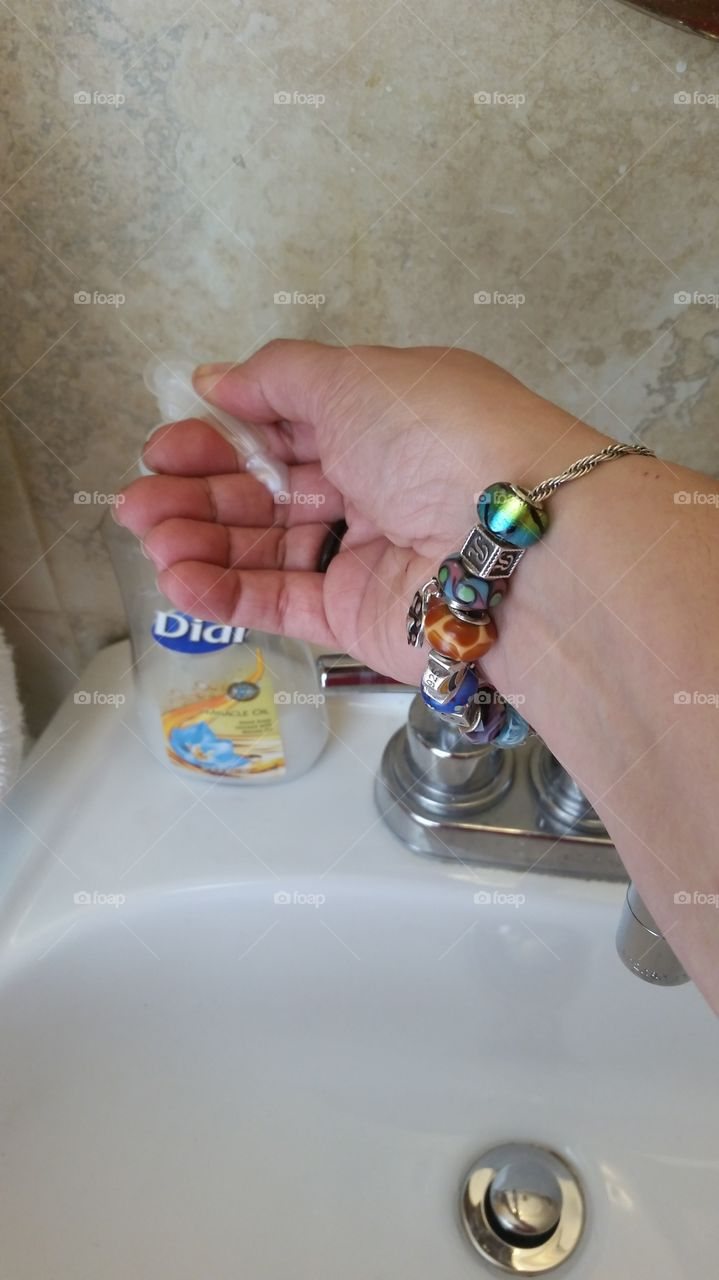 personal point of view, dispensing soap into hand