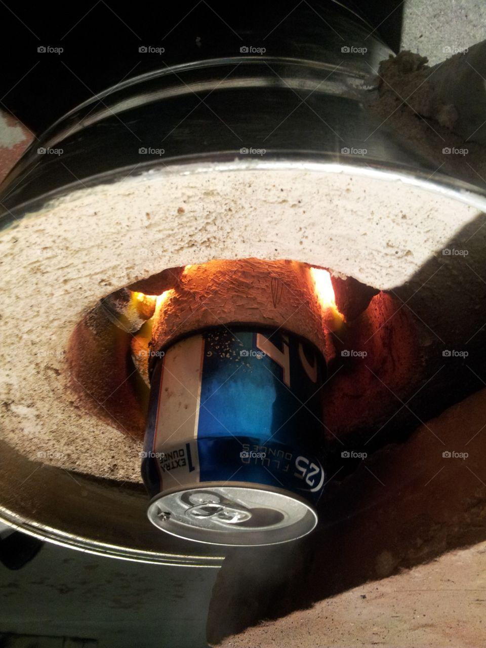 Melting soda cans into aluminum ingots