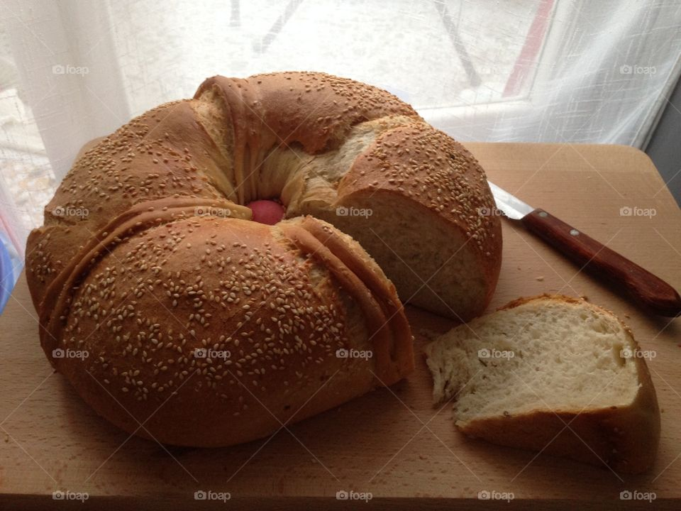 Fresh loaf of bread prepared for Easter with a red egg in the centre