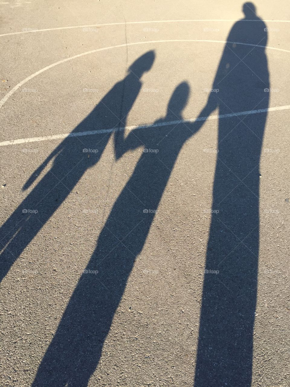 Shadow of people standing together