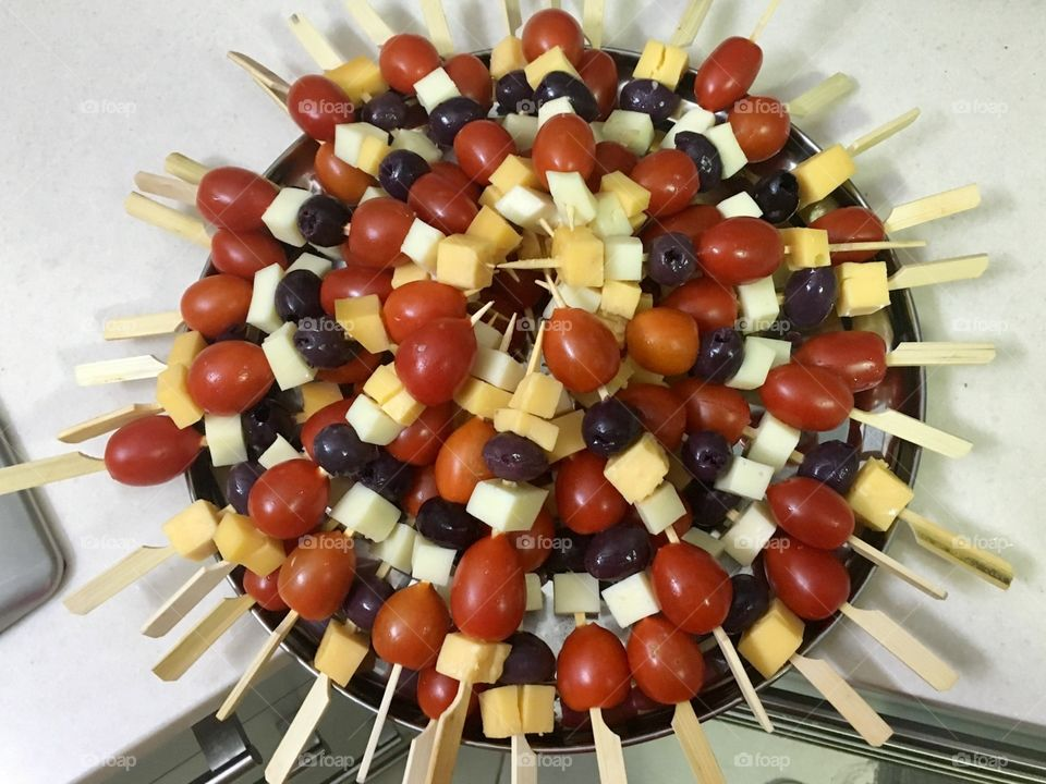 Cheese tomatoes and olives on a stick