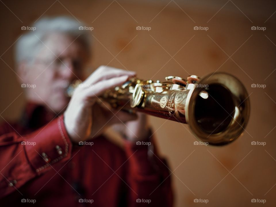 Close-up of a saxophone player