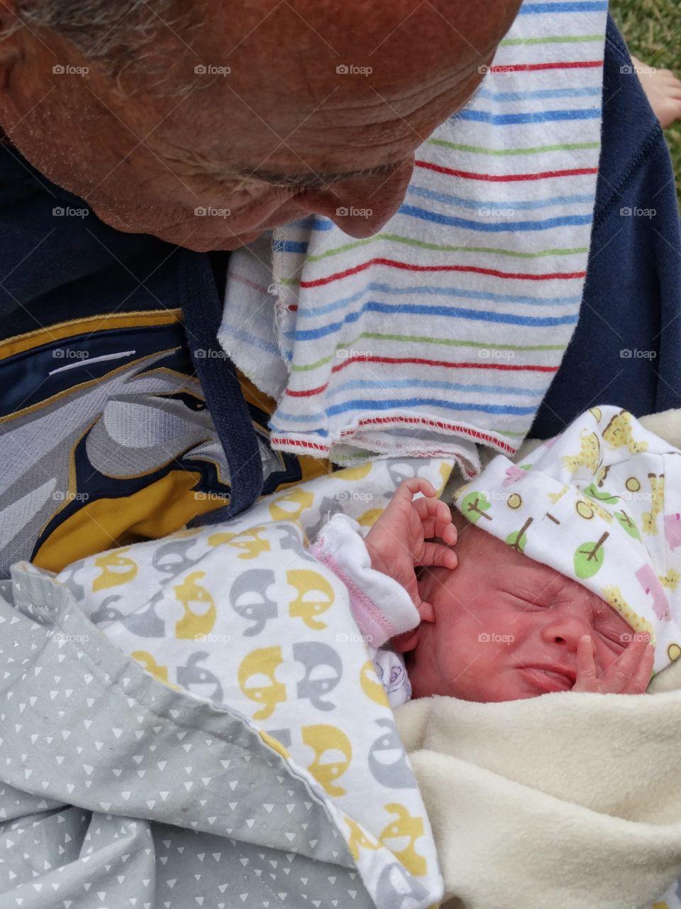 Grandfather Holding Newborn Baby