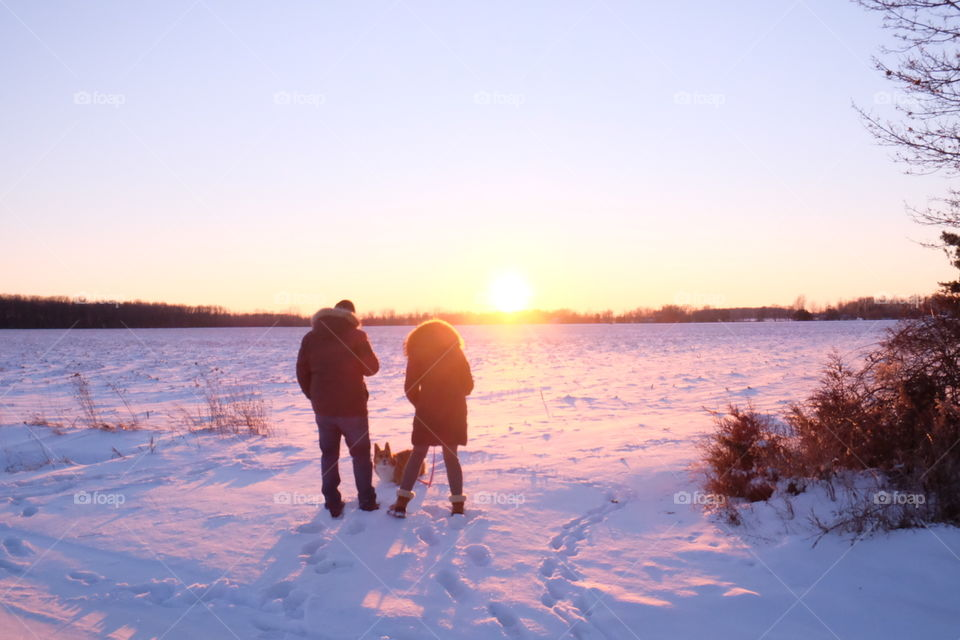 Family time in the winter sunset