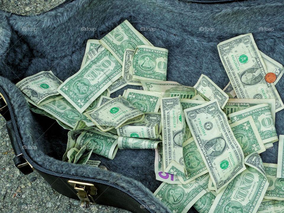 Dollar Bills In A Guitar Case