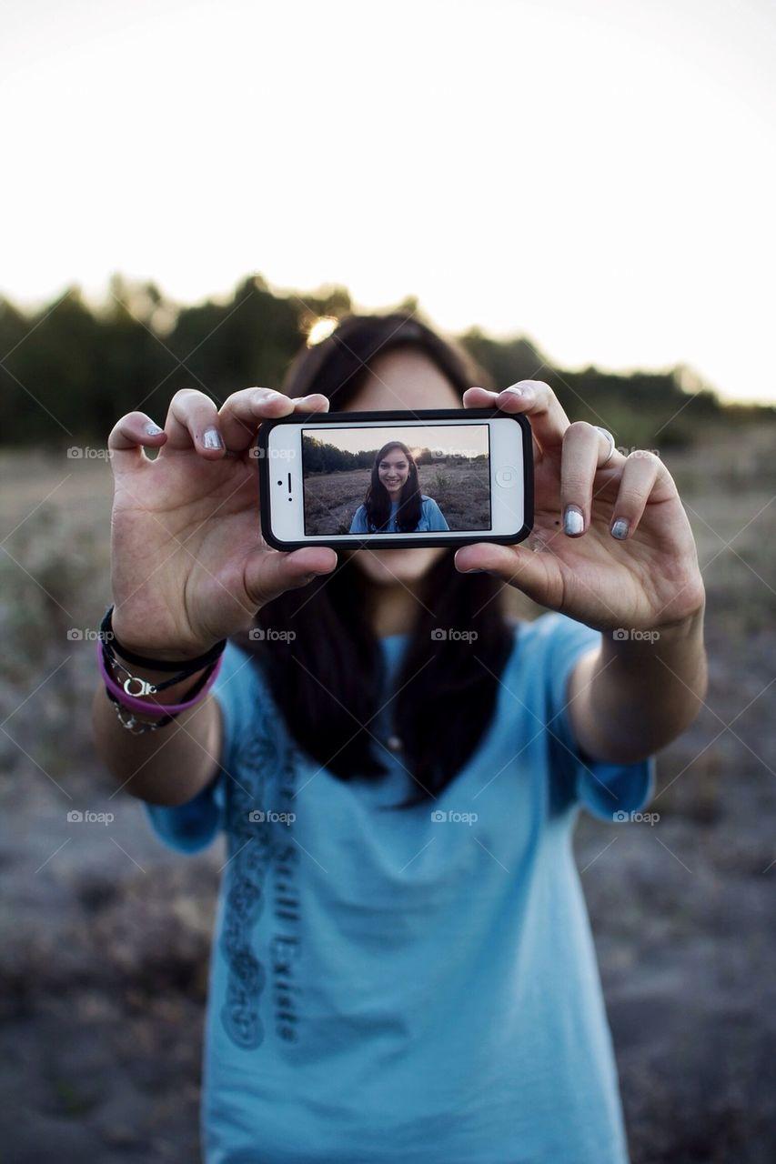 Girl taking a selfie