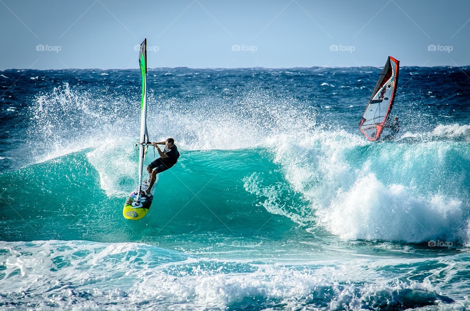 surfing on Maui . Surfer having fun on the waves on Maui
