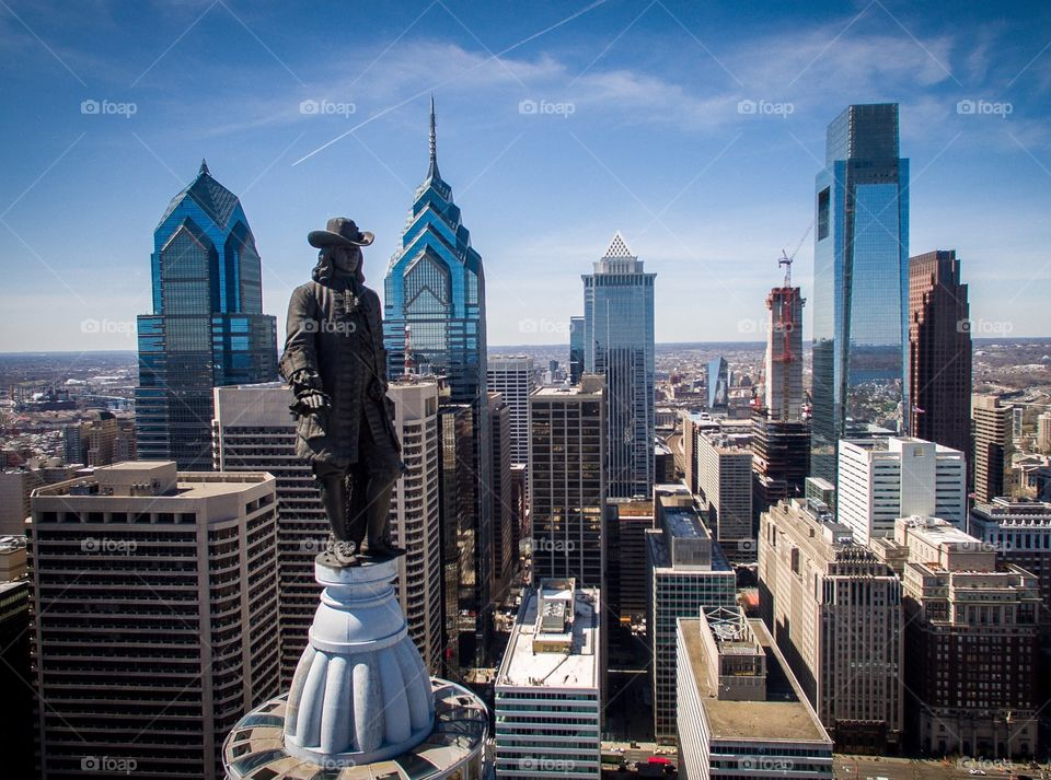 Skyline of Philadelphia from the air with the statue of William Penn atop Philadelphia City Hall in the foreground.