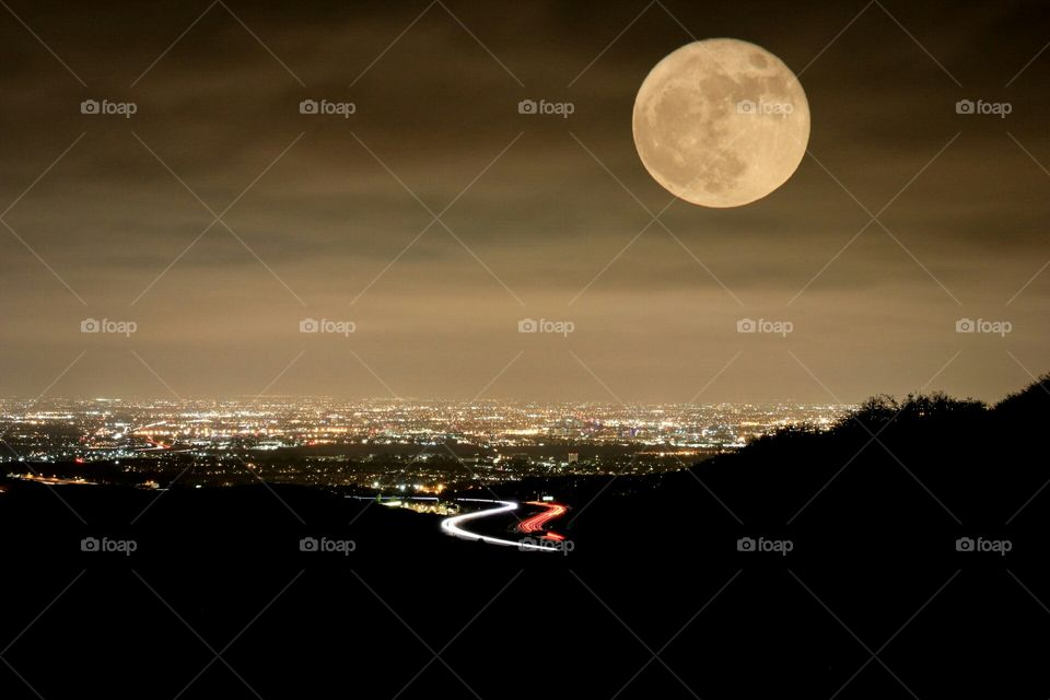 Super moon over Glittering city