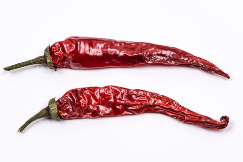 Two Hot Peppers on white background
