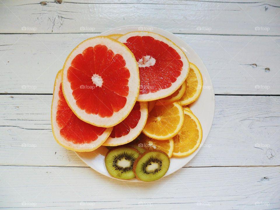 Citrus fruit slices on plate