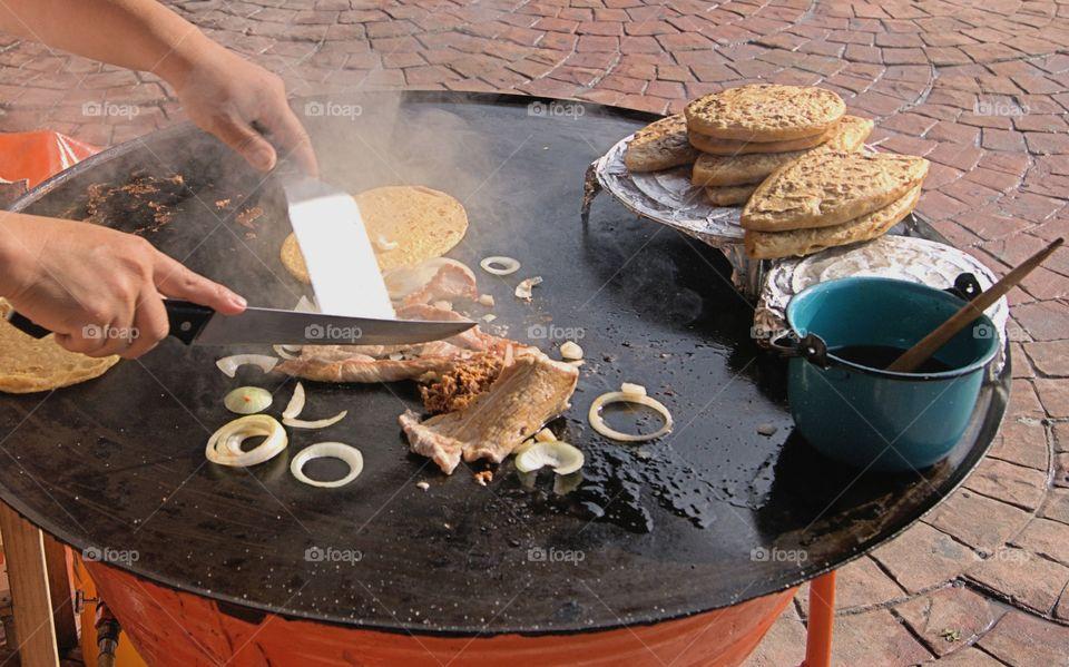 Person preparing tortillas