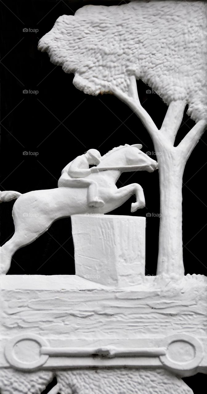 Saratoga Art. Wrought iron art of the steeplechase  thoroughbred jumping a fence. Black and white image of sculptured art Fleetphoto