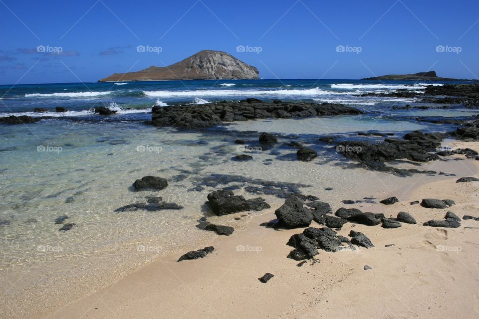 Lanikai Beach Oahu, Hawaii. A soft sand beach with the Mokes offshore.