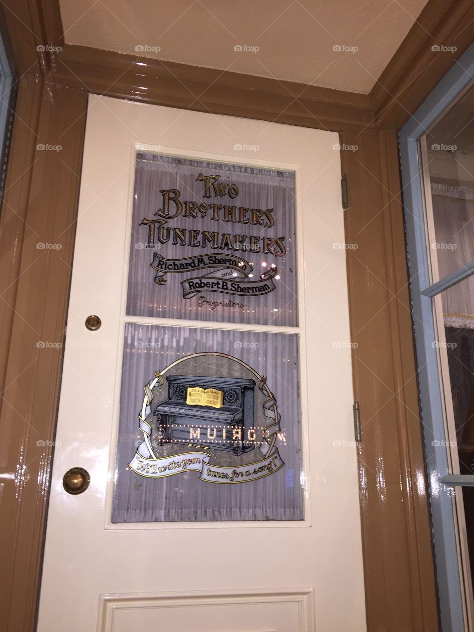 Disneyland Door Dècor. Sherman Brothers. The Brothers Tunemakers. Anaheim, California. May 2019.