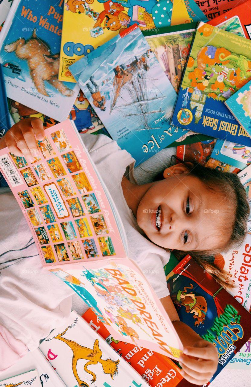 Girl reading story books