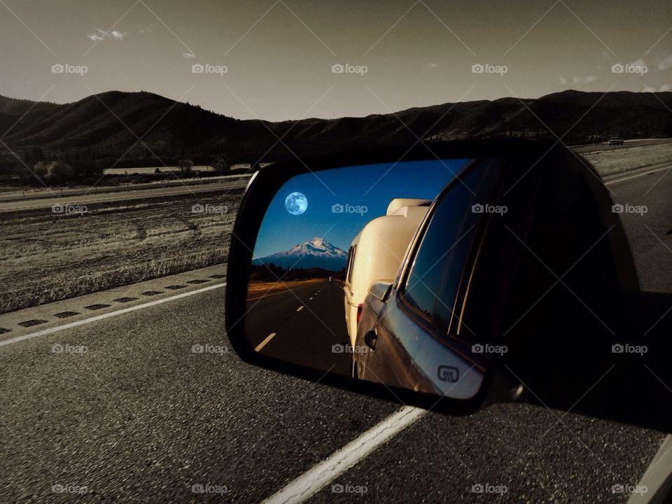 Rear view mirror: full moon over Mt Shasta